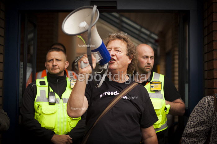 Dave Gibson, part organiser of the Barnsley Freedom Riders group, addresses the Barnsley Freedom Riders to let them know they will not be able to stage a freedom ride today due to the police and revenue protectors. Barnsley train station, South Yorkshire. - Connor Matheson - 2014-08-21