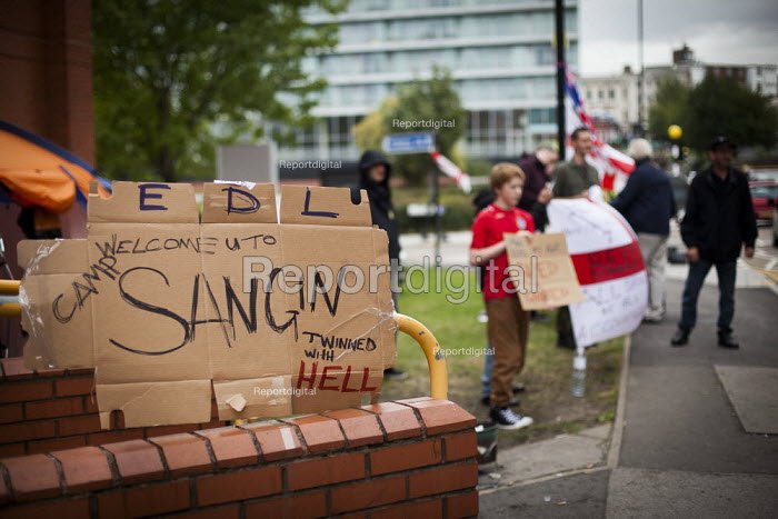 EDL members camp outside Rotherham police station demanding Police Commissioner Shaun Wright resign from his post. Rotherham Centre, South Yorkshire. - Connor Matheson - 2014-08-29