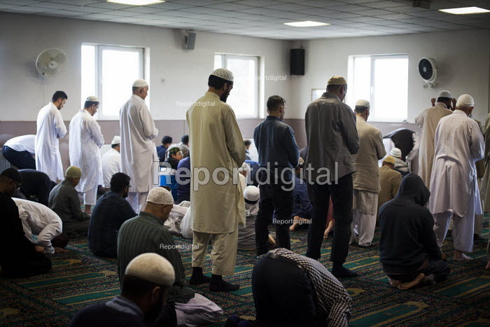 Muslim pray during Friday prayer. Rotherham Centre, South Yorkshire. - Connor Matheson - 2014-08-29