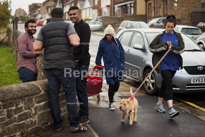 White women walk past Asian men. Rotherham Centre, South Yorkshire. - Connor Matheson - 2014-08-29