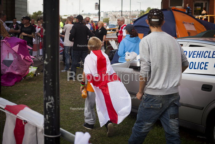A young EDL member walks around the camp outside of Rotherham Police Station. Rotherham Centre, South Yorkshire. - Connor Matheson - 2014-08-30