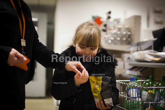 A young girl buying her favourite sweets. The Community Shop, Goldthorpe, South Yorkshire. - Connor Matheson - 2014-12-16