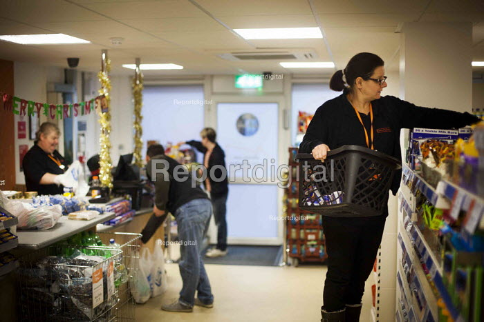 A staff member stacking shelves. The Community Shop, Goldthorpe, South Yorkshire. - Connor Matheson - 2014-12-16