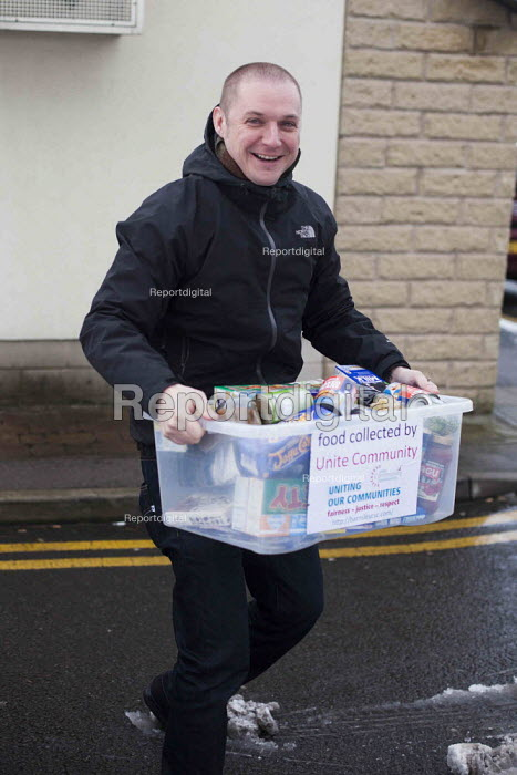 Joe Rollin from Unite community donates food to the Gateway foodbank Barnsley. Community support centre Barnsley - Connor Matheson - 2015-01-29