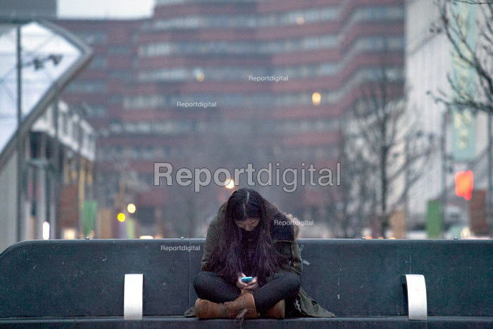 A girl using an Iphone. Sheffield centre. - Connor Matheson - 2015-02-15
