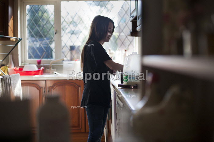 A young girl making a cup of tea. Ryhill, Wakefield, South Yorkshire. - Connor Matheson - 2015-03-01