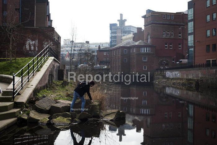 A young man relaxing by the river Don. Sheffield, South Yorkshire. - Connor Matheson - 2015-03-20
