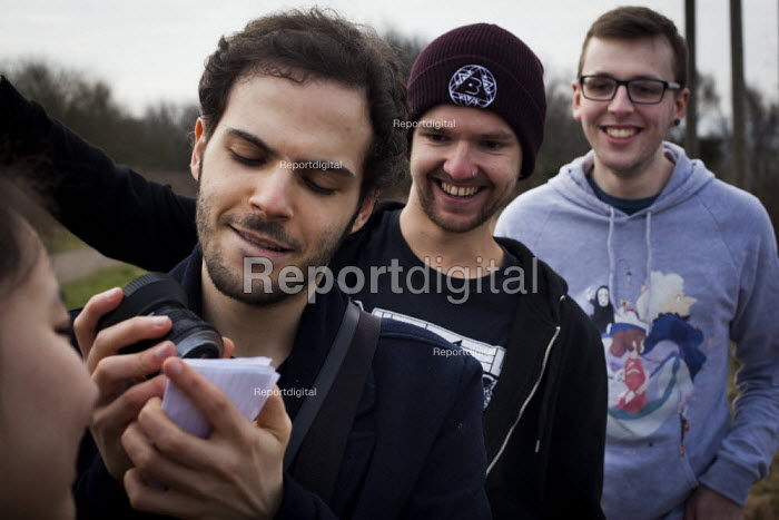 Local people looking at a projected image of the Solar Eclipse as the moon passes infront of the sun. Sheffield South Yorkshire. - Connor Matheson - 2015-03-20