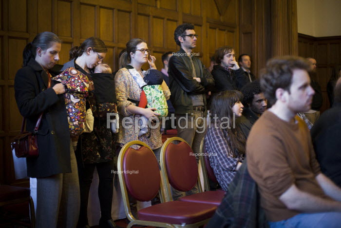Protesters inside Sheffield Town Hall watching the council planning committee debate and vote on whether a row of shops on Devonshire Street, including shop rare and racy, should be demolished and a new development by CODA should take place. The development was approved. Sheffield, South Yorkshire. - Connor Matheson - 2015-03-24