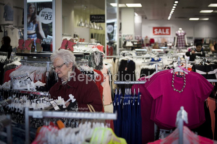 An elderly women shopping in a Select Fashion clothing shop. The Moor, Sheffield City Centre. - Connor Matheson - 2015-03-30