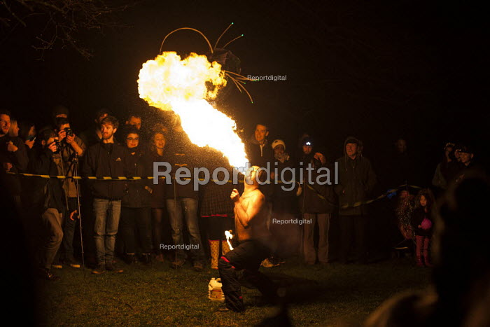 A fire eater breathing flames during his act. Sharrow Lantern Festival, a carnival where Local people make and parade lanterns in the streets, Sharrow, Sheffield, South Yorkshire. - Connor Matheson - 2015-04-12