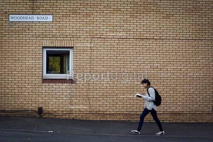 A student reading and walking, Highfield, Sheffield, South Yorkshire. - Connor Matheson - 2015-04-16