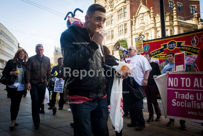 Mcdonald's customers eating food. Protest at McDonald's, Sheffield, South Yorkshire. Global day of action for fast food workers rights and fair pay, Youth Fight for Jobs campaign and BFAWU - Connor Matheson - 2015-04-18