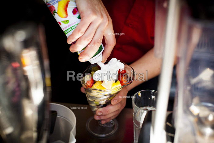 A hotel worker making a fruit salad. Tourism is a vital industry for the maltese economy, contributing 15 to its GDP. Since 2009 Malta has experienced a 10 drop in tourism. Tropicana Hotel. Saint Julians, Malta. - Connor Matheson - 2015-04-21