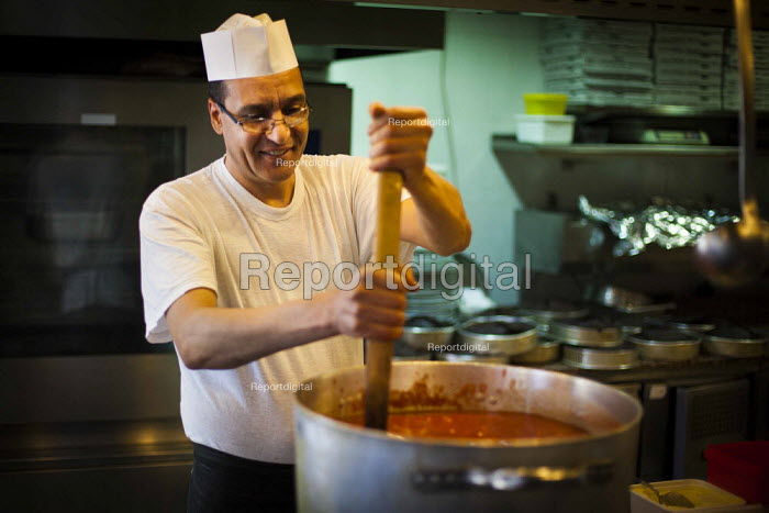 Chefs preparing food, stirring the pot Tropicana Hotel kitchen. Tourism is a vital industry for the maltese economy, contributing 15 to its GDP. Since 2009 Malta has experienced a 10 drop in tourism. Tropicana Hotel. Saint Julians, Malta. - Connor Matheson - 2015-04-21
