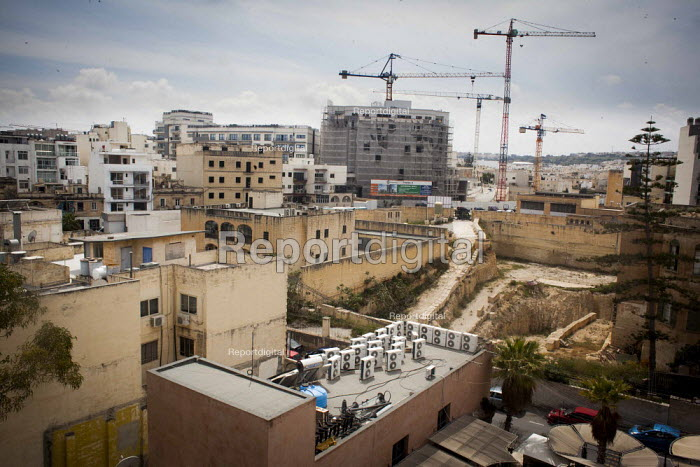 A view of Saint Julians with Mitsui air conditioning units and new construction work. Saint Julians, Malta. - Connor Matheson - 2015-04-21