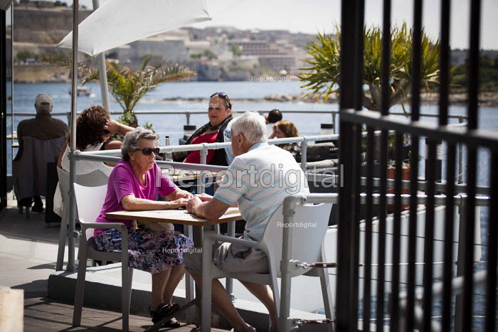 Tourists having dinner by the sea. Tourism is a vital industry for the maltese economy, contributing 15 to its GDP. Since 2009 Malta has experienced a 10 drop in tourism. sliema, Malta. - Connor Matheson - 2015-04-23
