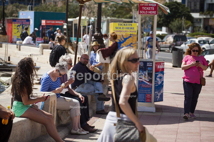 Tourists waiting for boat tours around Malta and Gozo. Tourism is a vital industry for the maltese economy, contributing 15 to its GDP. Since 2009 Malta has experienced a 10 drop in tourism. sliema, Malta. - Connor Matheson - 2015-04-23
