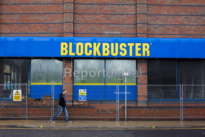 A closed down Blockbuster retail unit. Blockbuster filed for bankruptcy in 2010 and has closed down 9,000 stores largley due to changes in the industry including the introduction of video streaming sites such as netflixs. Barnsley Centre, West Yorkshire. - Connor Matheson - 2015-05-03