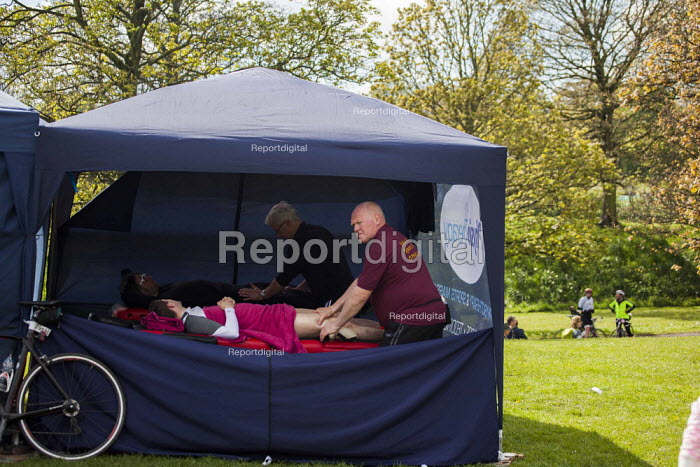A massage warm down tent for those who have cycled to the Tour De Yorkshire finish line. Roundhay Park, Leeds, West Yorkshire - Connor Matheson - 2015-05-03