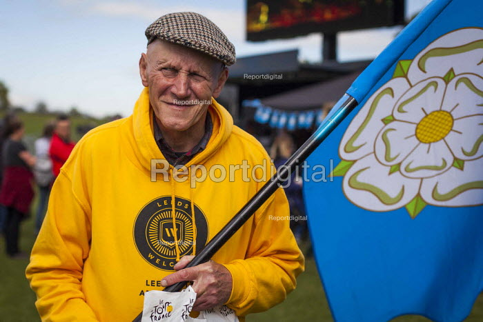 A volunteer for the Tour De Yorkshire with a Yorkshire flag. Roundhay Park, Leeds, West Yorkshire - Connor Matheson - 2015-05-03