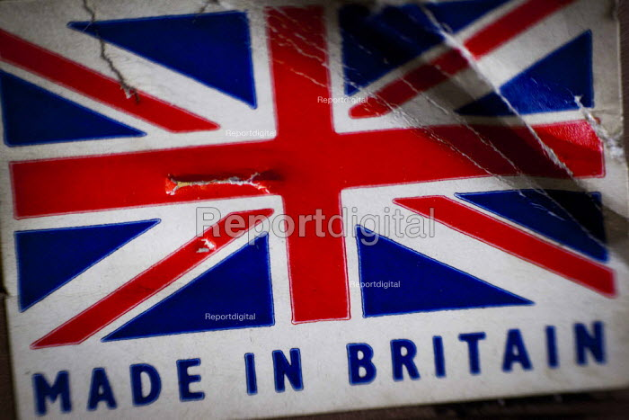 A Made in Britain sticker. J Adams and Sons manufacture a range of military and cooking knives out of steel using traditional hand based production methods. The family business employs around 16 people part time and has been passed down from son to son for three generations. Much of the knives are exported for the American market. J, Adams and Sons Cutlers and Knives factory, Sheffield centre, South Yorkshire. - Connor Matheson - 2015-05-18