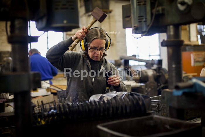 A worker making wooden handles. J Adams and Sons manufacture a range of military and cooking knives out of steel using traditional hand based production methods. The family business employs around 16 people part time and has been passed down from son to son for three generations. Much of the knives are exported for the American market. J, Adams and Sons Cutlers and Knives factory, Sheffield centre, South Yorkshire. - Connor Matheson - 2015-05-18