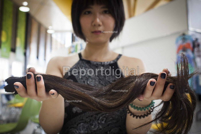 A Chinese student who has cut her own hair in order to sell it to Bloomsbury Wigs in London. She hopes to get around £50 for her hair which was 19 inches long. Some people with rare hair types have made a lot of money from selling their hair. Sheffield, South Yorkshire. - Connor Matheson - 2015-06-17