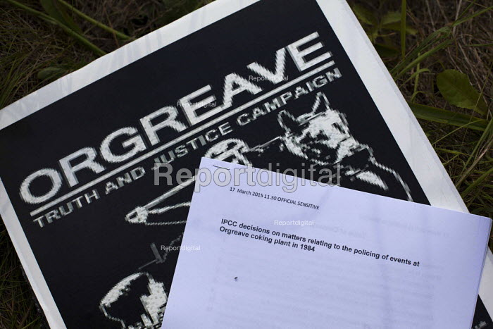 The IPCC decision document on a Orgeave Truth and Justice Campaign placard. Campaigners and supporters rally to mark the 31st anniversary of the battle of Orgreave which took place during the miners strike. Activists and victims are demanding a public enquiry into the abuse of police powers that took place. The IPCC recently said they would not be investigating the battle of Orgreave. Orgreave, Sheffield - Connor Matheson - 2015-06-18