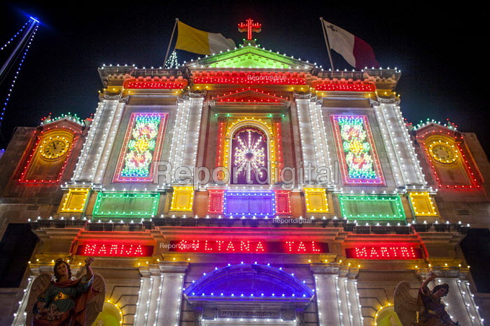 The Feast of Our Lady of Sorrows St. Pauls Bay Malta. Church lit up by hundreds of lightbulbs. The celebration is traditionally a celebration of the patron saint, but today the event is more of a community celebration - Connor Matheson - 2015-07-23