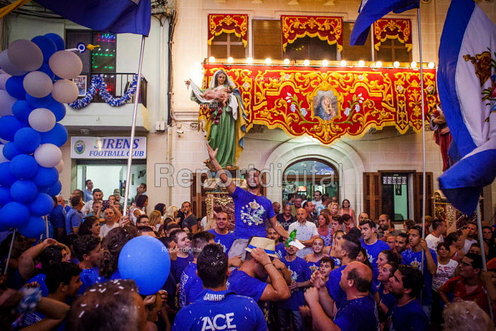 The Feast of Our Lady of Sorrows St. Pauls Bay Malta, cheering and jumping in the air outside the village church - Connor Matheson - 2015-07-24