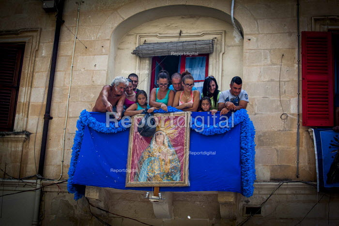 The Feast of Our Lady of Sorrows St. Pauls Bay Malta locals throwing confetti from their balcony - Connor Matheson - 2015-07-26