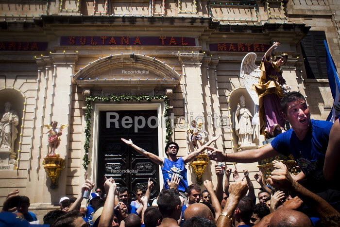 The Feast of Our Lady of Sorrows St. Pauls Bay Malta, cheering and jumping in the air outside the village church - Connor Matheson - 2015-07-26