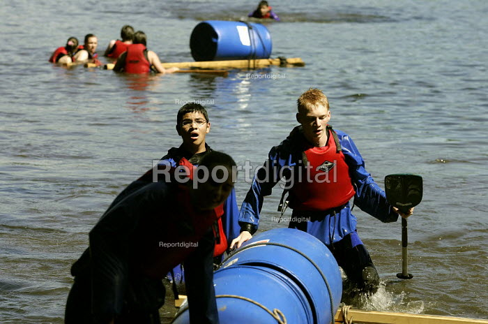 School pupils from Bolton taking part in the Patterdale Challenge, a series of outdooor adventure taks designed to link the independent Bolton School with its' state run neighbours. Pupils from Balderstone Schooll and Mount St Joseph swimming ashore after their rafts collapsed. - Christopher Thomond - 2005-07-11