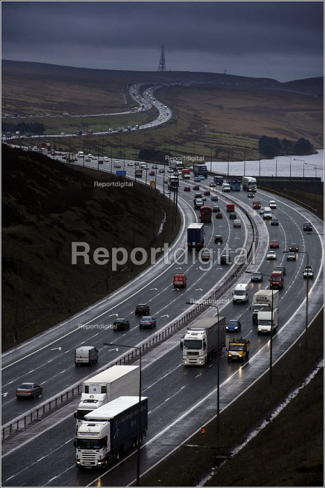 Heavy traffic on the M62 trans pennine motorway at Scammonden, West Yorkshire. This section between Manchester and Leeds is often beyond its capacity leading to traffic congestion - Christopher Thomond - 2006-03-14