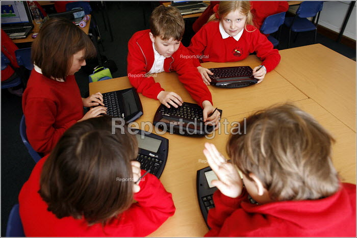 Pupils using their mini WiFi enabled laptops at the Hope School CE in Shropshire. - Christopher Thomond - 2005-12-01