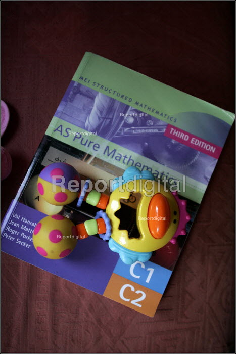 Childs toy rattle and a school text book on AS Pure Mathematics - Christopher Thomond - 2005-09-12