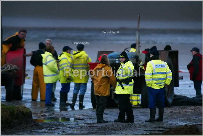 The search and rescue operation ( 6th February 2004) in Morecambe Bay, Lancashire, after cockle fishers were stranded on sandbanks by the incoming rising tide. The Chinese gangmaster, Lin Liang Ren was found guilty of the unlawful killing of the 21 workers who died in the incident. - Christopher Thomond - 2004-02-06