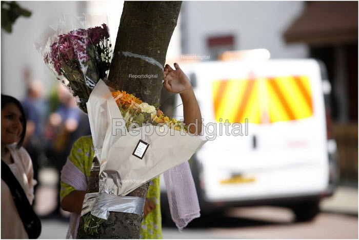 Flowers tied to a tree at the spot in Fishwick Parade , Preston, where 20 year old Shezan Umarji was stabbed to death in the early hours of Saturday in a racist incident. - Christopher Thomond - 2006-07-23