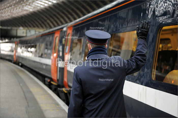 A member of the train station staff at York Railway Station blowing a whistle and signalling the train driver to depart. - Christopher Thomond - 2009-01-08