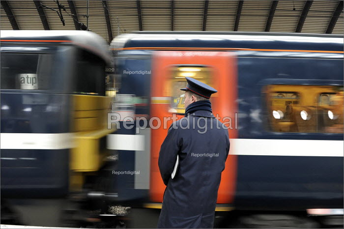 A member of the train station staff at York Railway Station as a train departs - Christopher Thomond - 2009-01-08