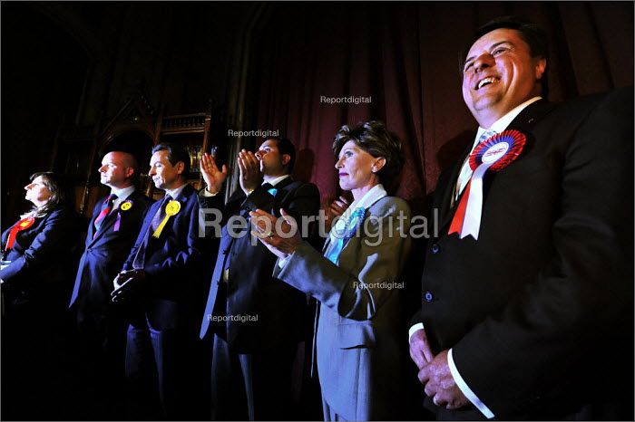 European elections voting results at Manchester Town Hall. BNP leader Nick Griffin laughs off criticism from his felow newly elected MEPs on stage after the declaration. - Christopher Thomond - 2009-06-08