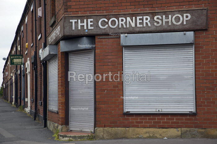 A closed corner shop in the Derker area of Oldham, due to be redeveloped as part of a government Pathfinder scheme. . - Christopher Thomond - 2009-06-12