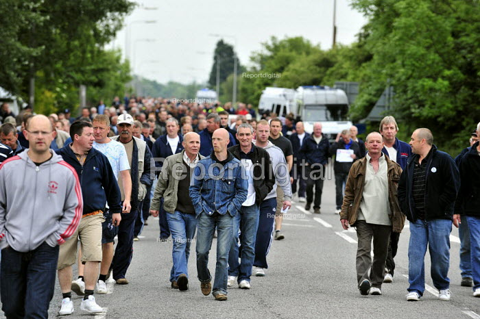 Workers march to gather in protest outside the Total Lindsey oil refinery in Lincolnshire, after colleagues at the nearby Conoco plant joined the industrial action. - Christopher Thomond - 2009-06-22