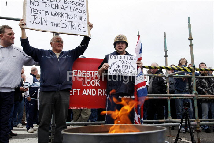 Sacked workers gather in protest outside the Total Lindsey oil refinery in Lincolnshire. Burning their letters of dismissal from the French company. - Christopher Thomond - 2009-06-22