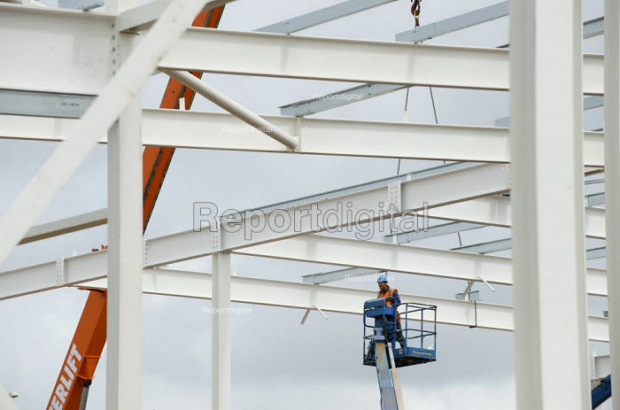 Worker on a hydraulic lift. Construction of a new Tesco supermarket at Litherland. - Christopher Thomond - 2009-07-07