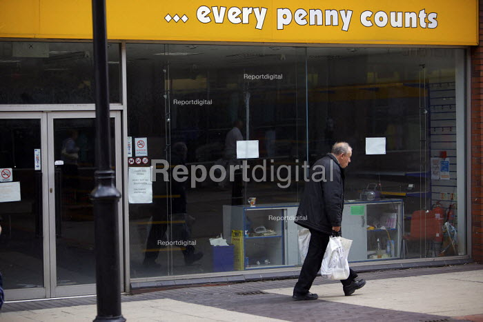 An elderly shopper walking through Rotherham town centre walks past a closed shop Every Penny Counts... - Christopher Thomond - 2009-07-23