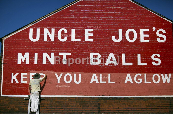 Painting the sign at The Uncle Joes Mintballs Works in Wigan - Keep you all aglow. - Christopher Thomond - 2009-09-15
