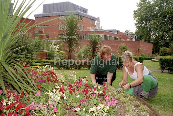 Prison Officer ( left) & inmate working in the prison Garden Holloway womens prison. - Duncan Phillips - 1999-08-15