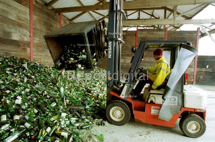 Camden Council Recycling Depot. Collected Glass being sorted by driver in a forklift truck. - Duncan Phillips - 2000-04-14